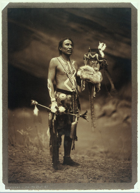 L0033500 A Navajo man in ceremonial dress representing the Yebichai g Credit: Wellcome Library, London. Wellcome Images images@wellcome.ac.uk http://wellcomeimages.org A Navajo man in ceremonial dress representing the Yebichai god Zahabolzi (Zahadolzha?). Photograph by Edward S. Curtis, 1904. Silver gelatine print 1904 By: Edward S. CurtisPublished: 1904. Copyrighted work available under Creative Commons Attribution only licence CC BY 4.0 http://creativecommons.org/licenses/by/4.0/